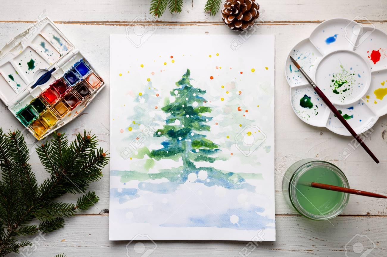 Watercolor Christmas Cards.Handmade Watercolor Christmas Card On The Work Table With Watercolor