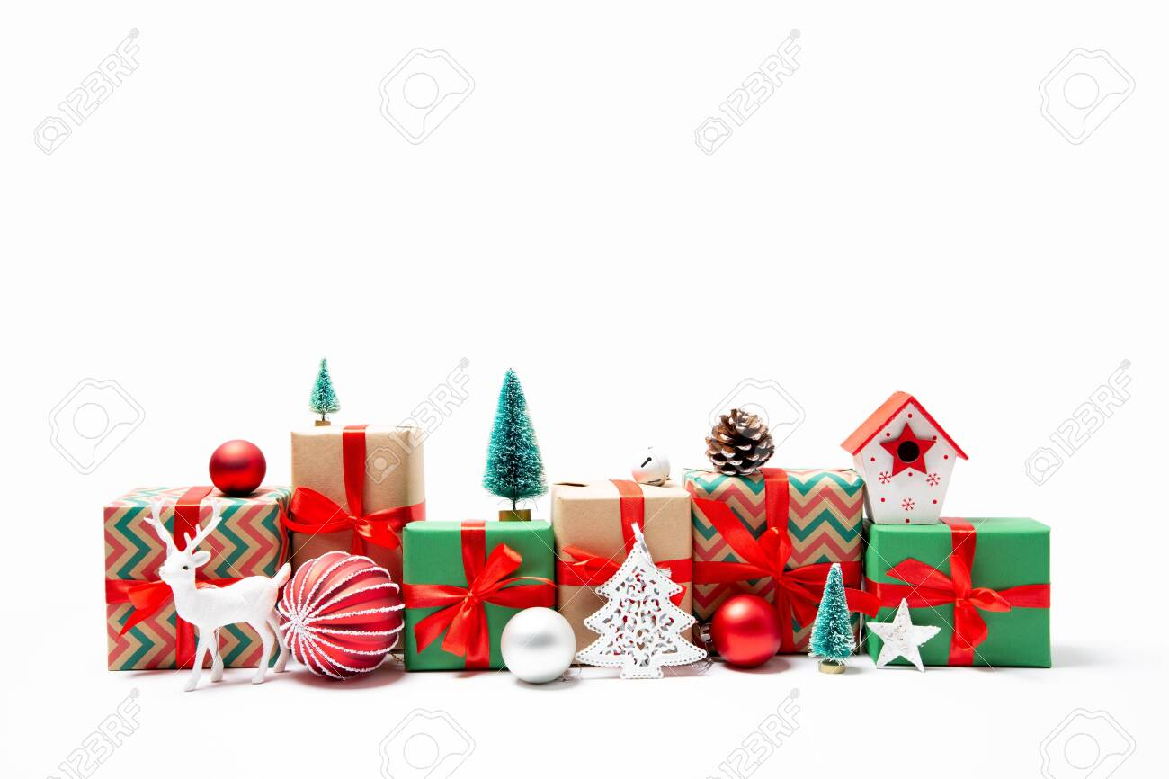 Christmas gifts and ornaments in a row in the shape of a cityscape. Isolated on white - 130792414