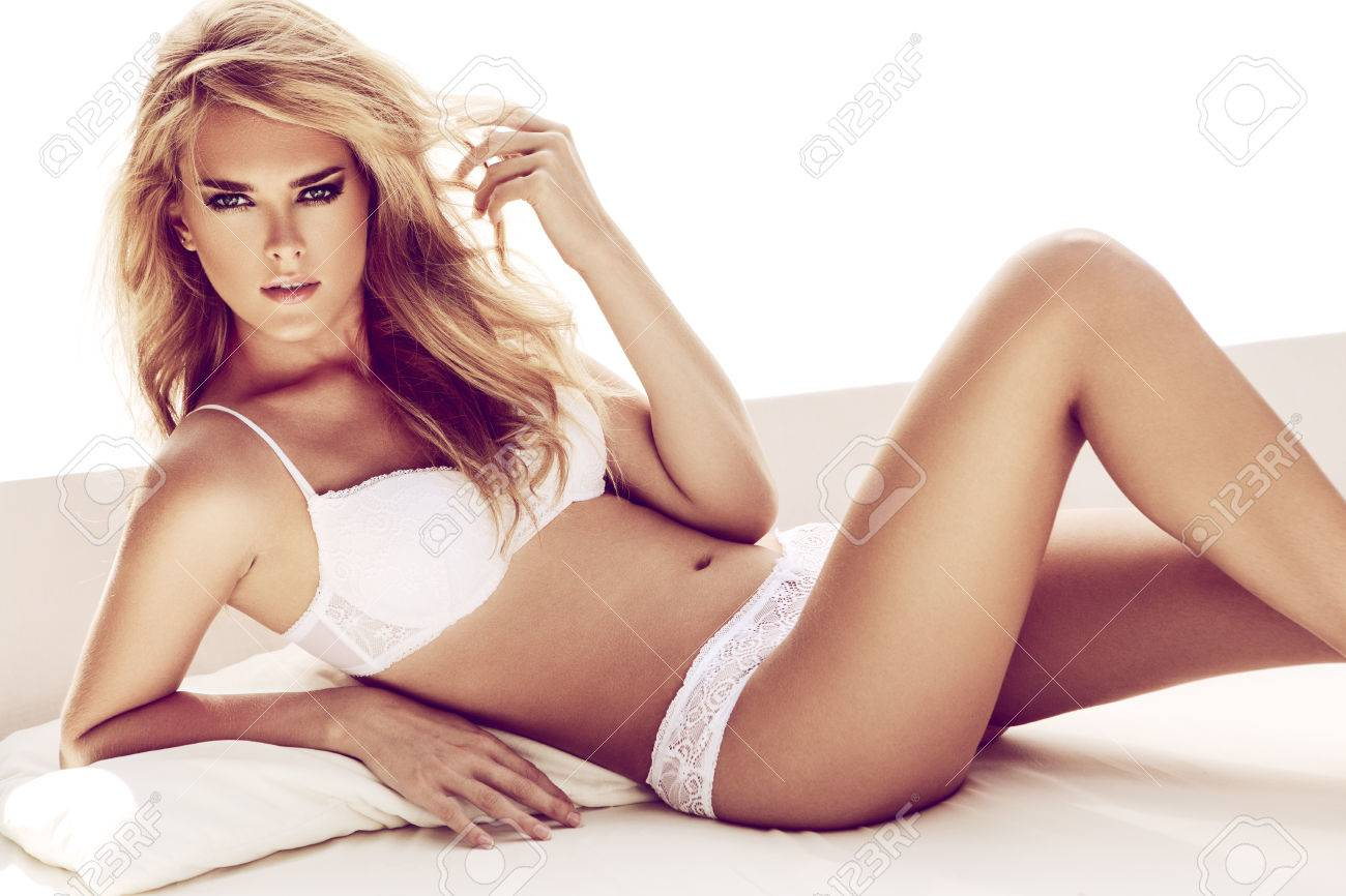 Sexy Blond Woman Posing In White Bed Stock Photo Picture And Royalty Free Image Image 50888176