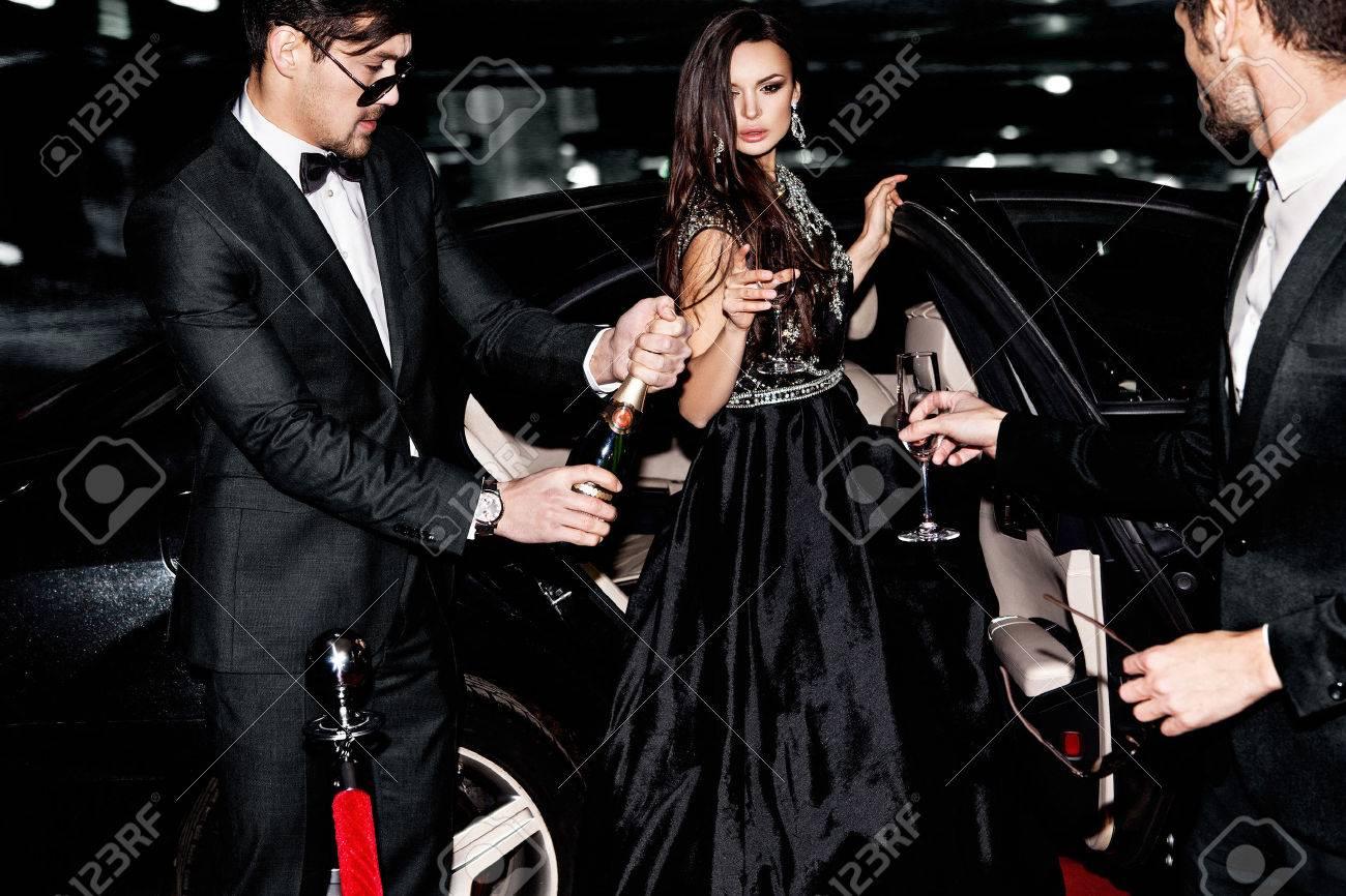 Friends near the car. Hollywood star. Celebrating. - 57773156