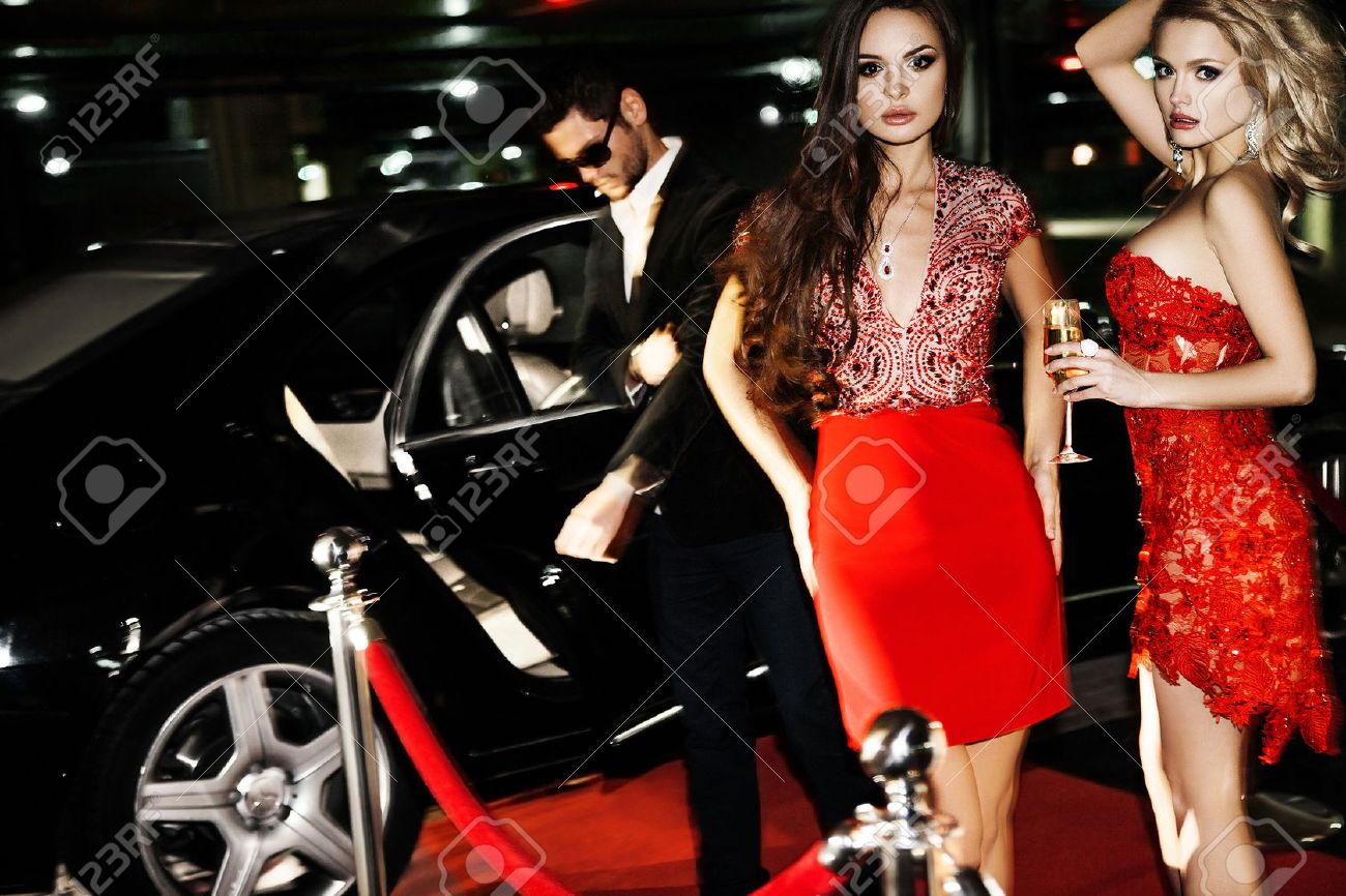 Sexy couple in the car. Hollywood star. Fashionable pair of elegant people at night city street. - 57857485