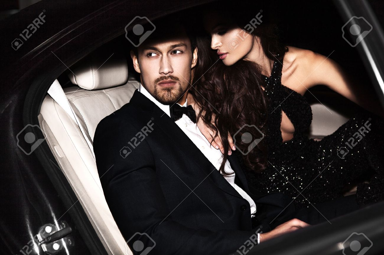 Sexy couple in the car. Hollywood stars. - 57773183