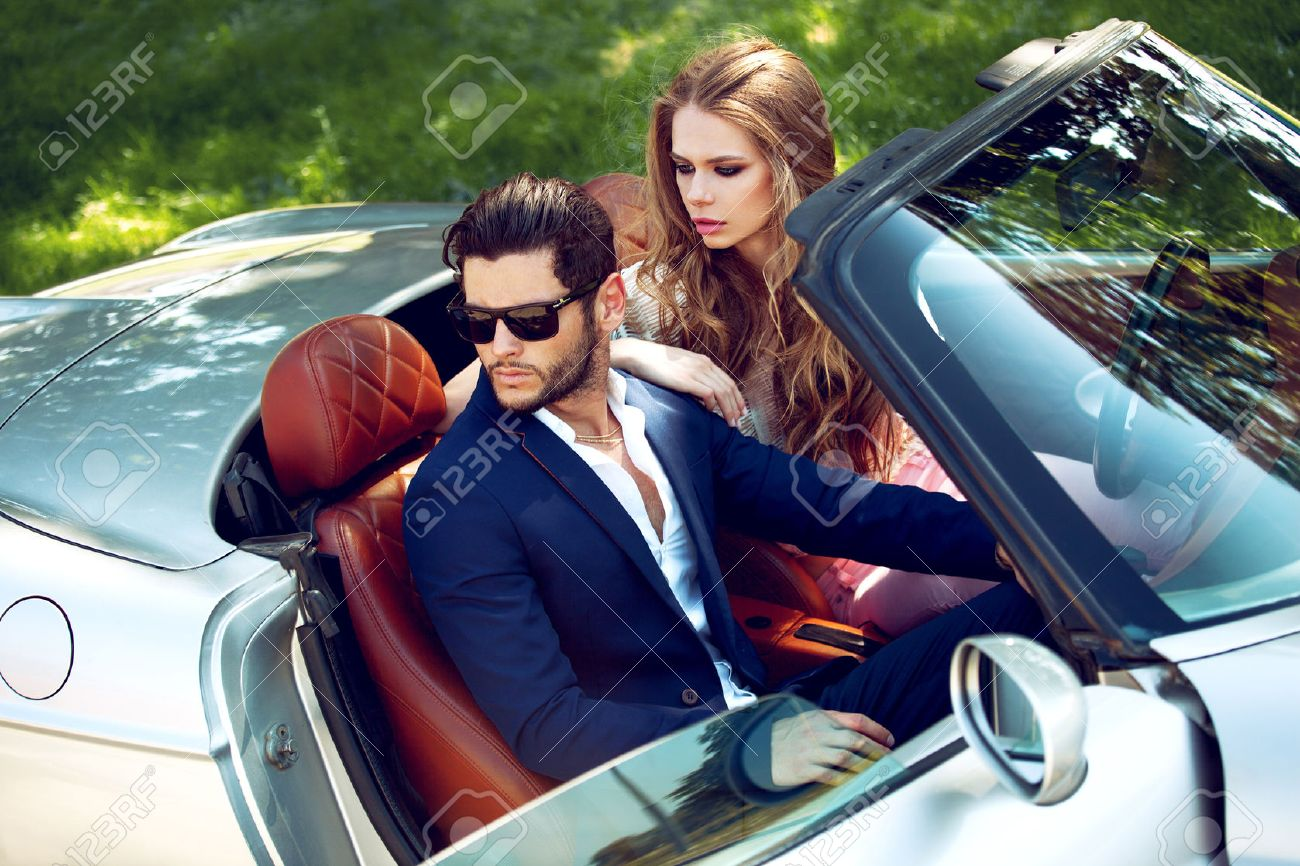 Sexy couple in the car. Luxury life. - 74893409