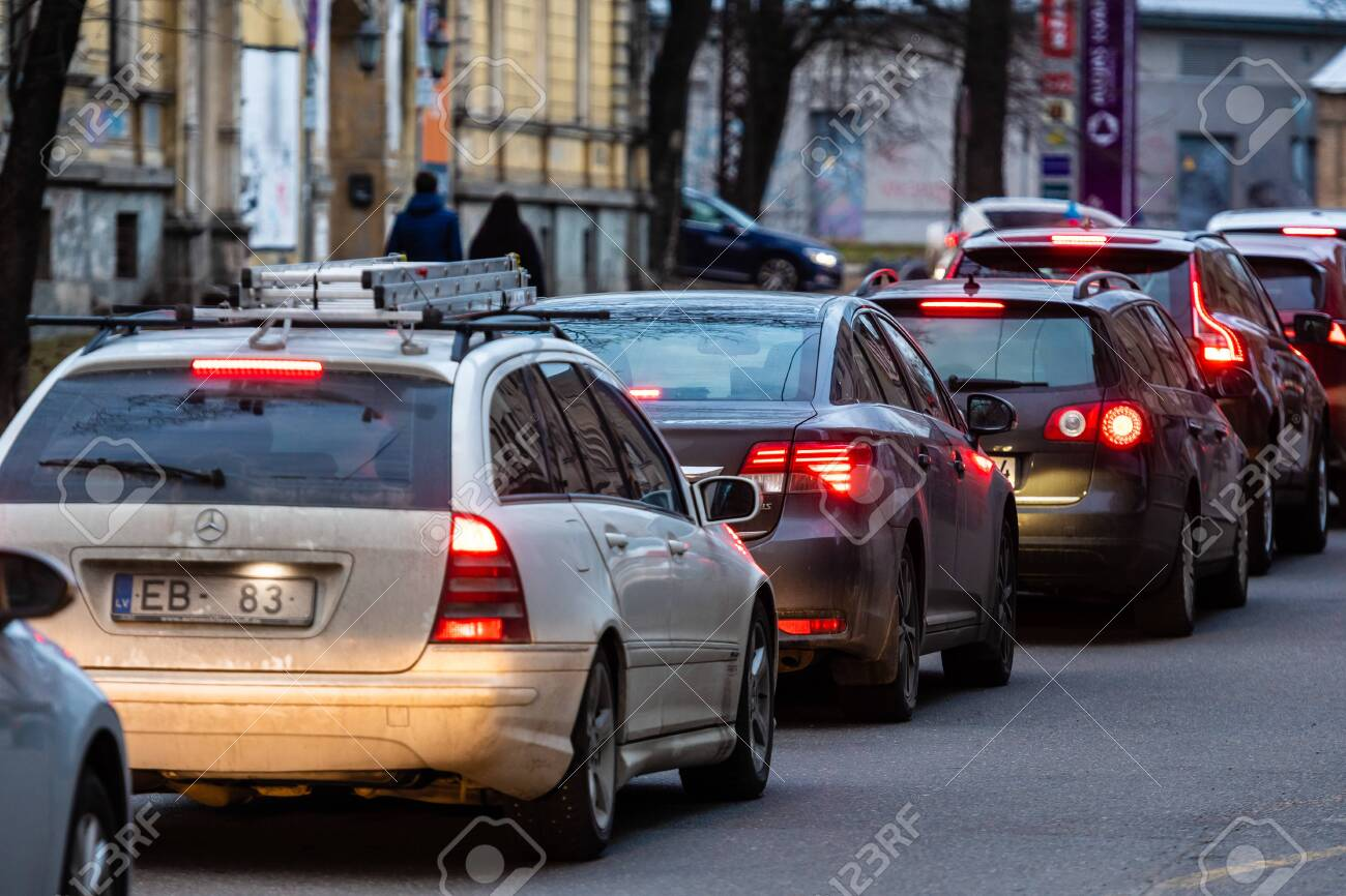 RIGA, LATVIA - MARCH 27, 2019: Traffic jams in the city with row of cars on the road at evening and bokeh lights - image - 139137151