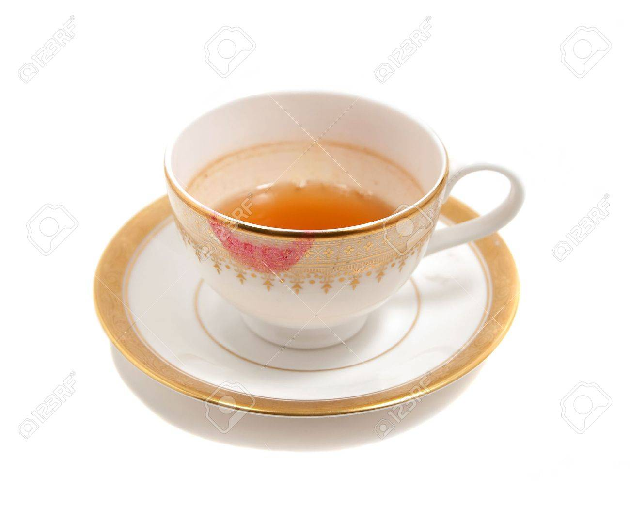 stained teacup with lipstick smear isolated on white - 5383328