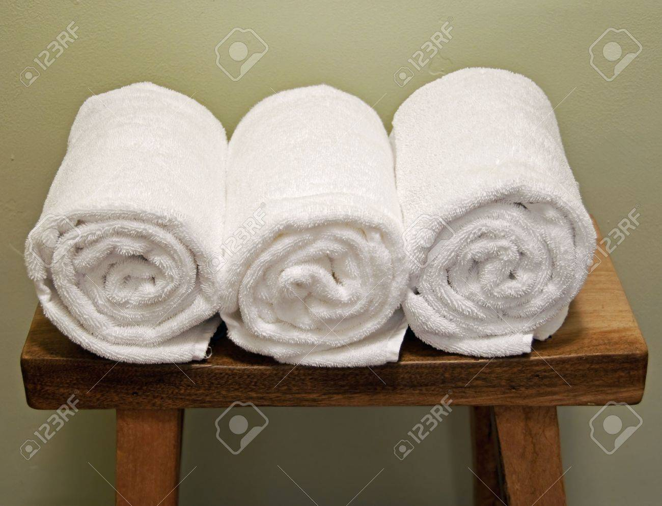 clean rolls of towels on a bench - 5744908