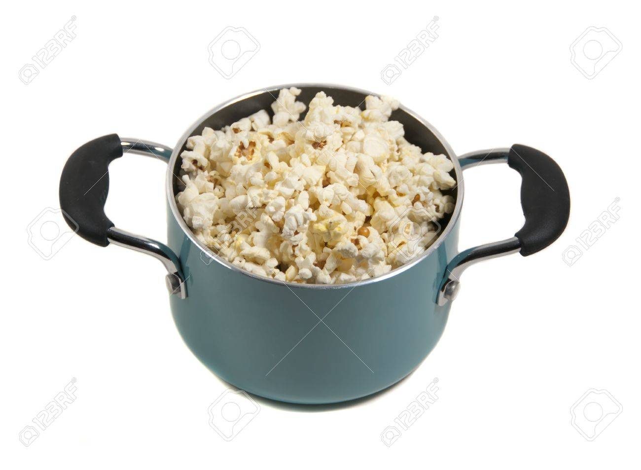 freshly popped corn in turquoise pot - 9651293