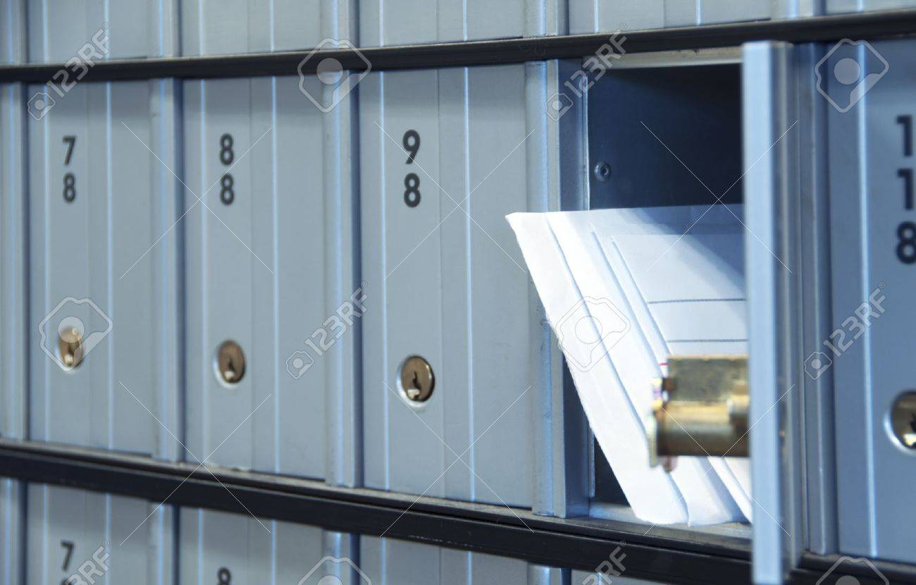 mail waiting in the u.s. grey/blue post office box - 9730761