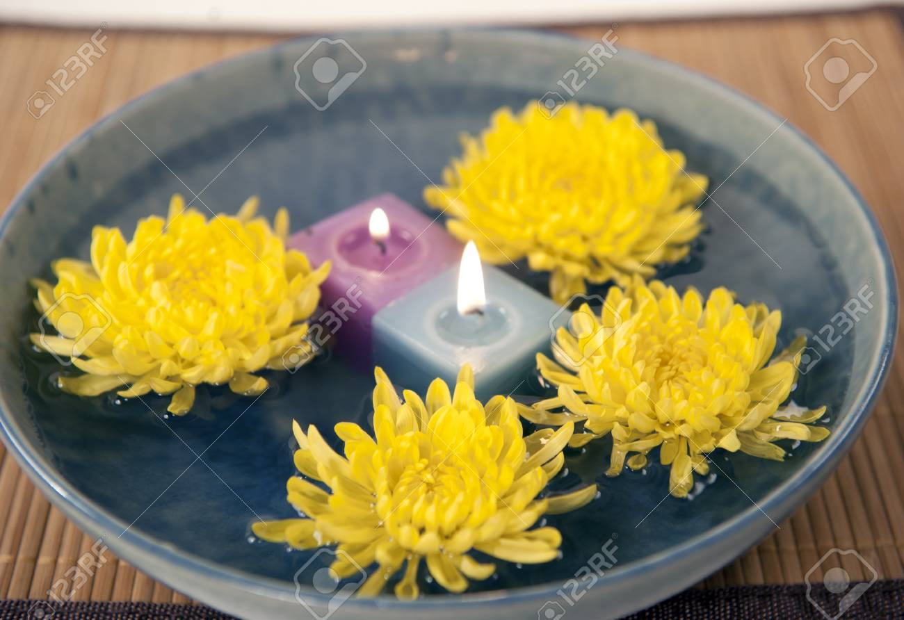 aromatherapy candles and mums in water - 10453191