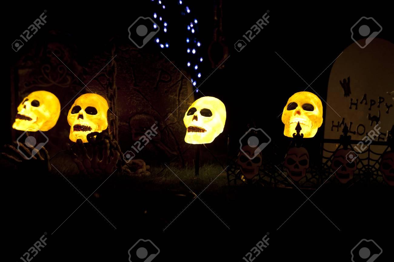 lighted skullcaps in a graveyard - 10453172