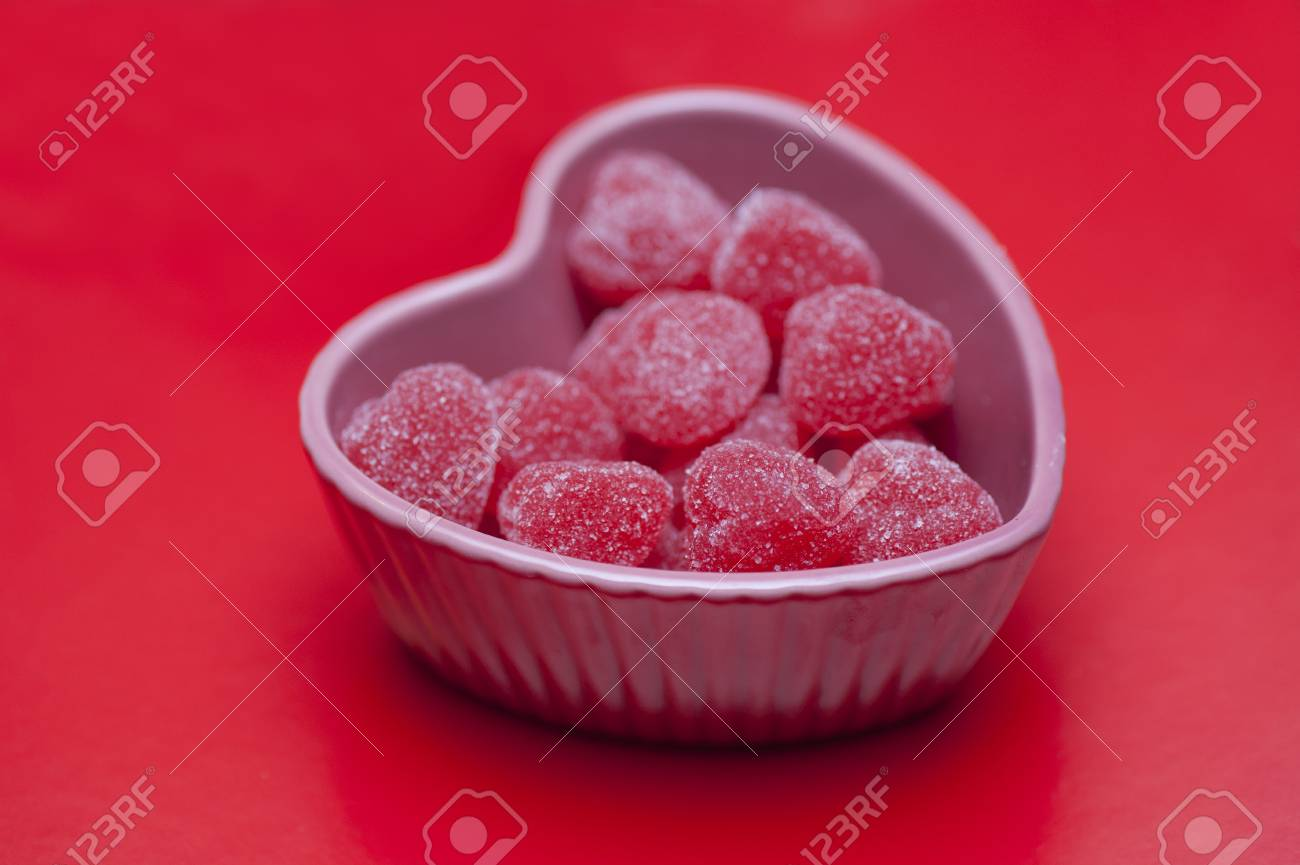 heart shaped candies in a heart shaped tray - 12113367