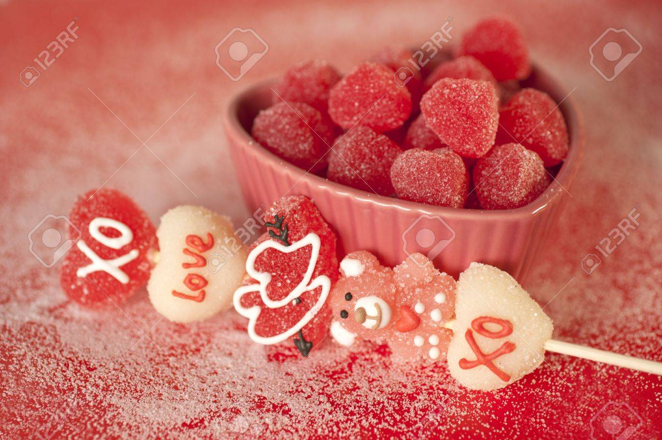 heart shaped candies in a heart shaped platter - 12113372