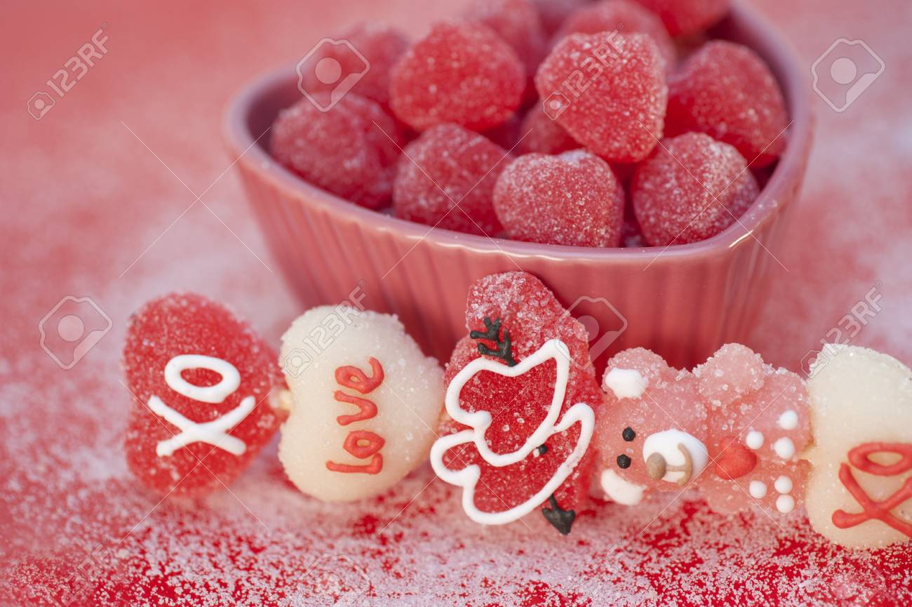heart shaped candies in a heart shaped platter - 12113369