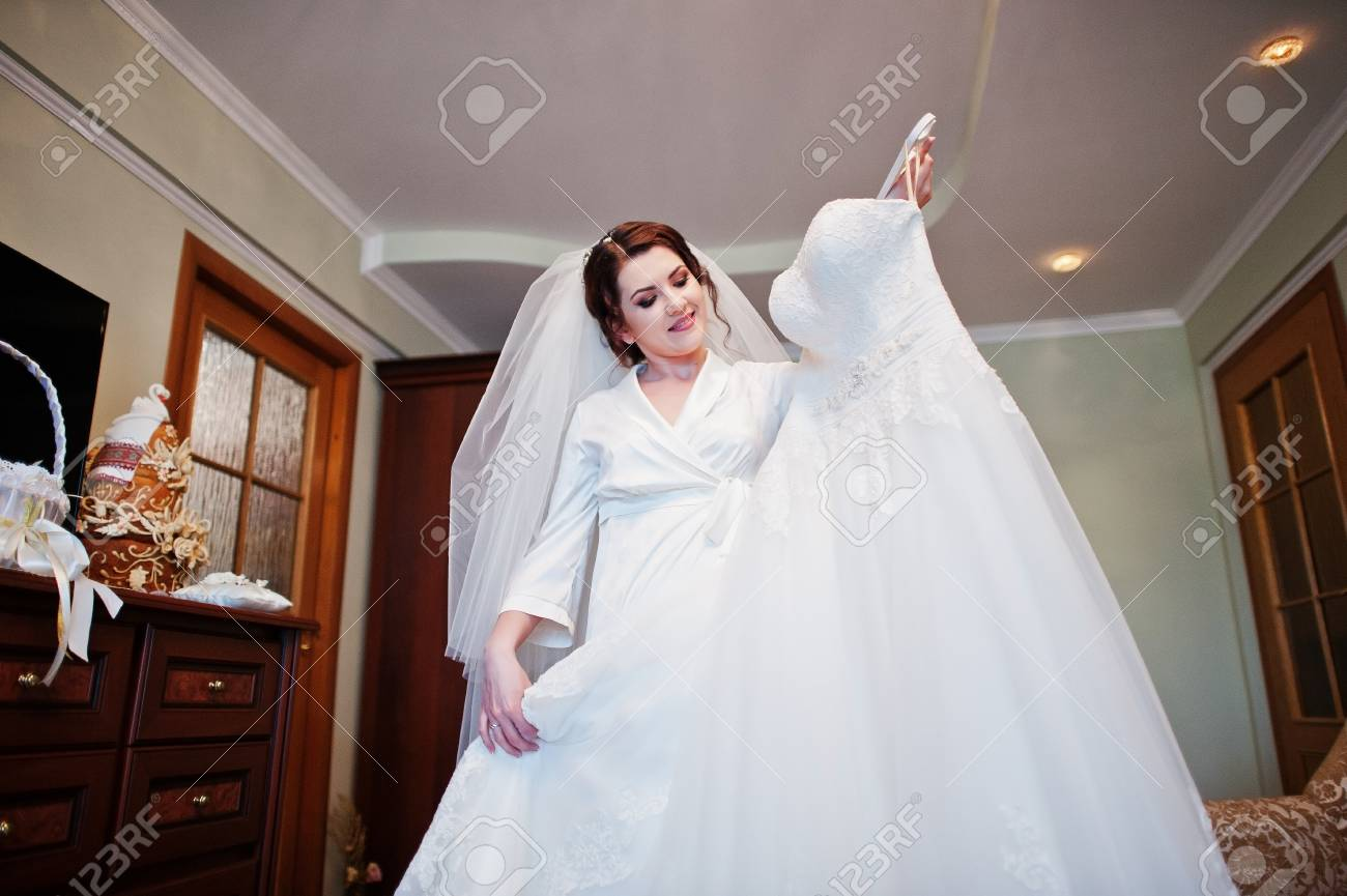 Smiling Brunette Bride Wearing On White Silk Gown Robe Holding ...
