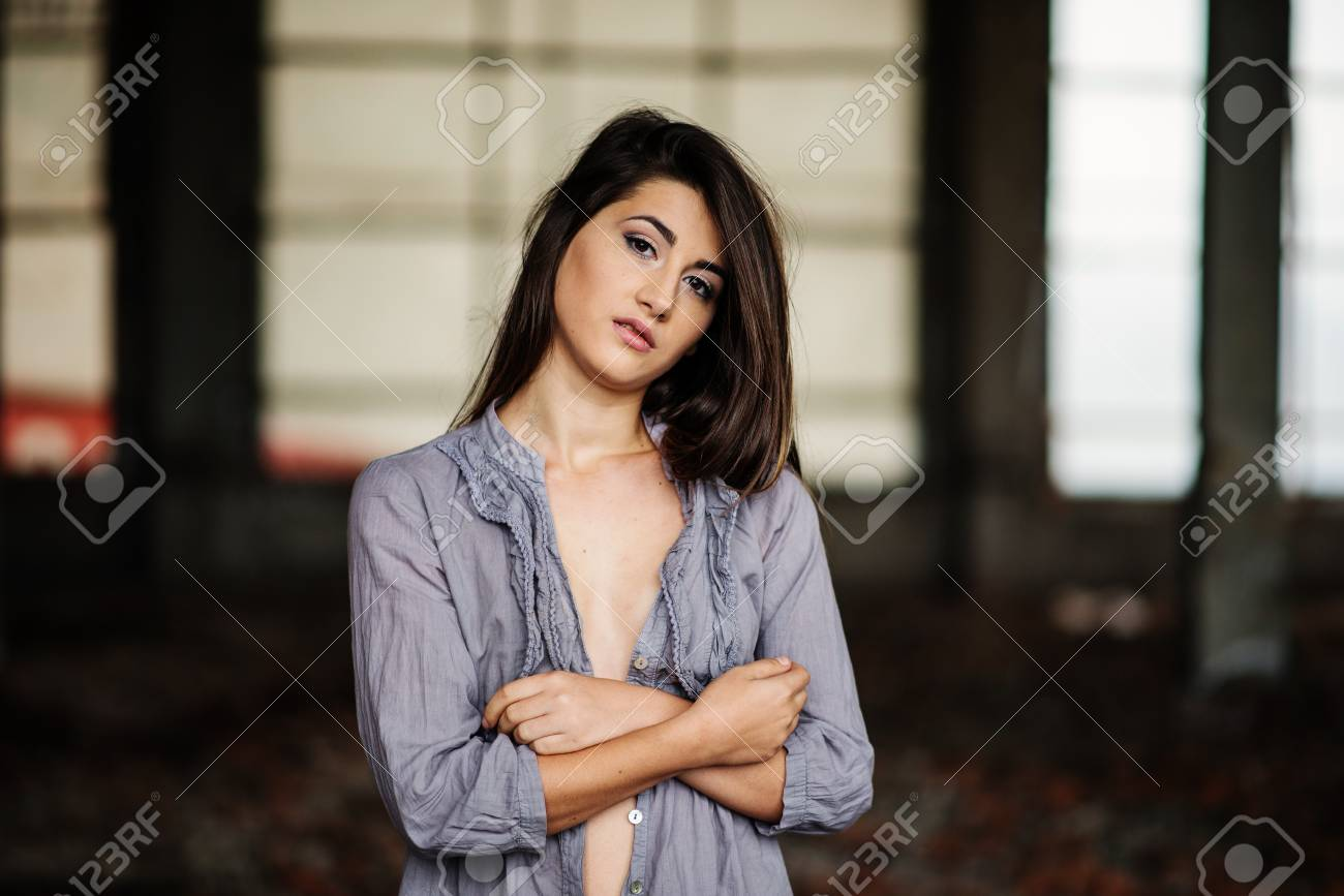 close up portrait of young cute brunette girl with slightly bust