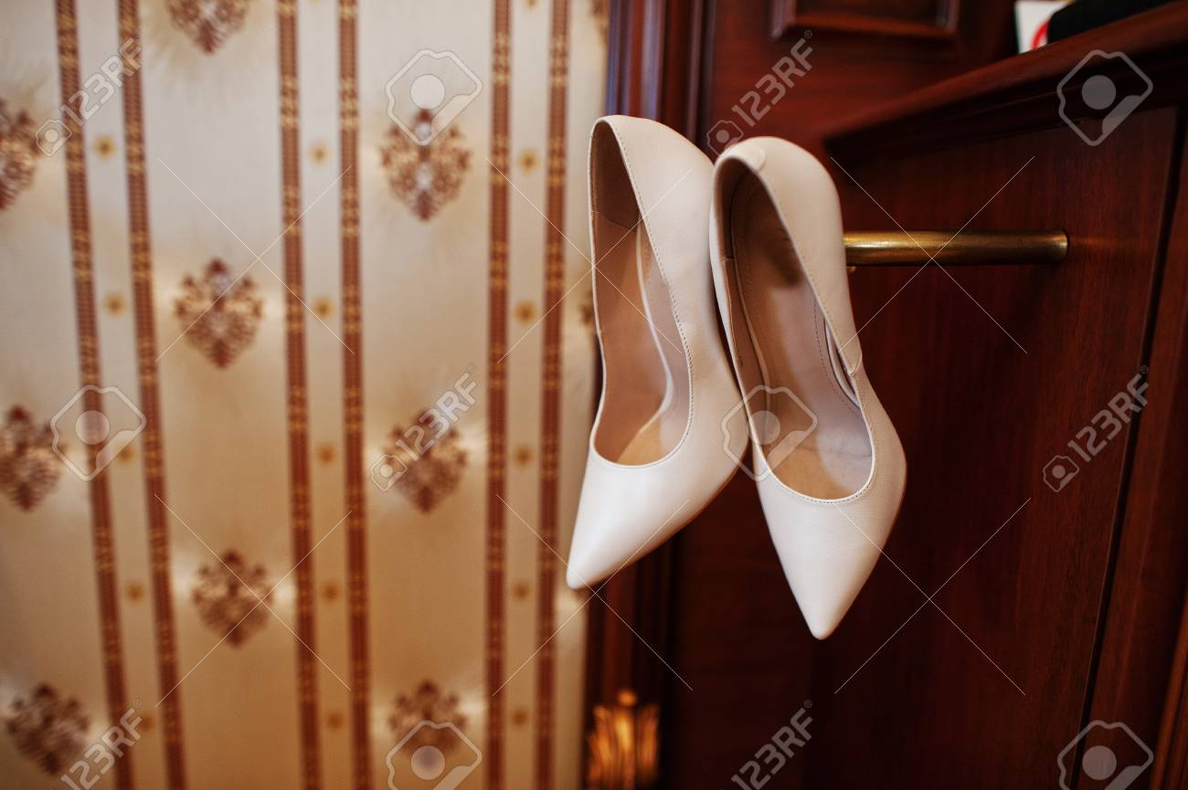 Beige Luxury Wedding Shoes At Wooden Cabinet On Hotel Room