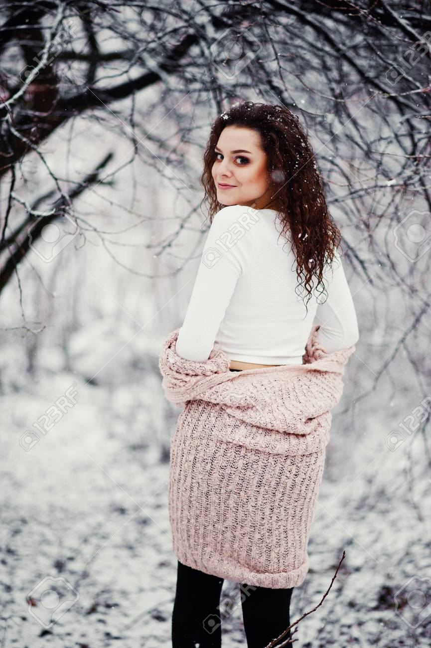 5eaa85b1eb Back Of Curly Brunette Girl Background Falling Snow