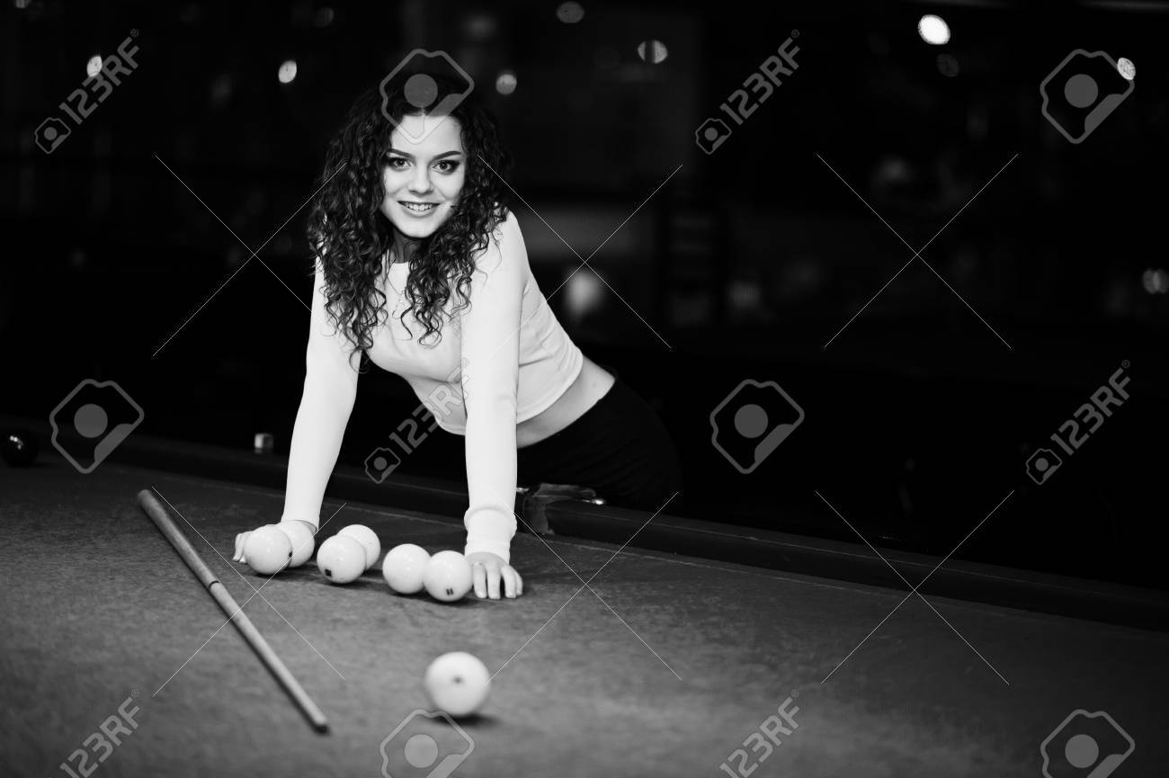 Stock Photo   Young Curly Girl Posed Near Billiard Table. Sexy Model At  Black Mini Skirt Play Russian Snooker. Play Game And Fun Concept.