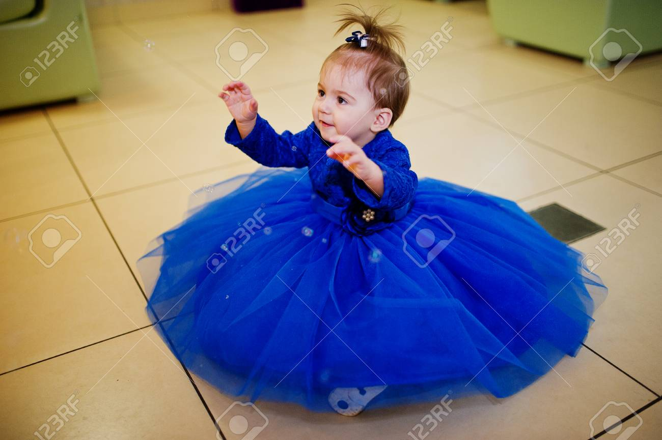d43db6a51 Cute Little Baby Girl At Blue Dress Play With Soap Bubbles. 1 ...