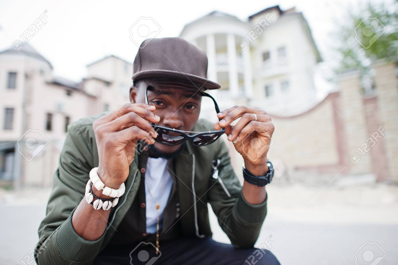 8bb659988d7c Close up portrait of stylish african american man wear on sunglasses and cap  outdoor. Street