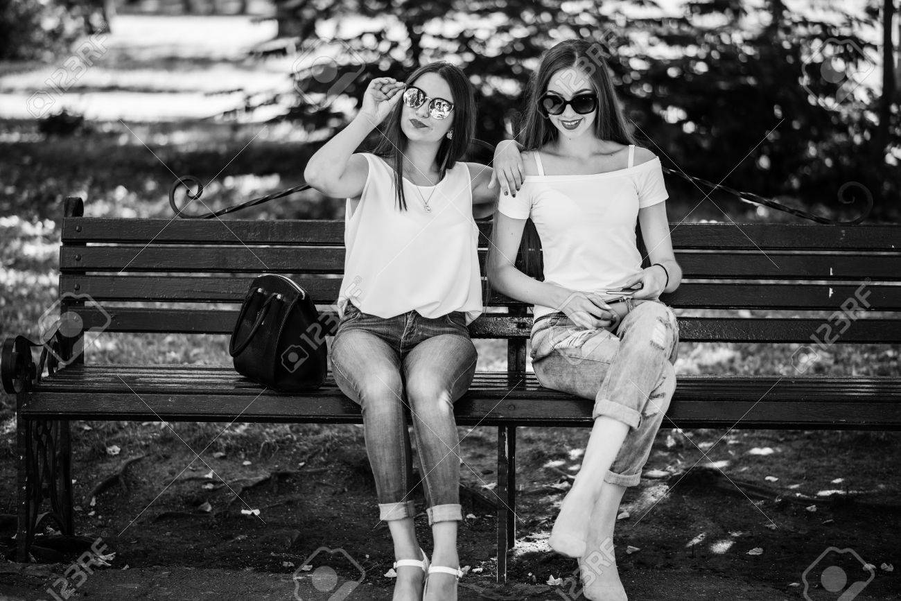 Fine Two Fabulous Girls Sitting On The Bench In The Park Black And Pabps2019 Chair Design Images Pabps2019Com