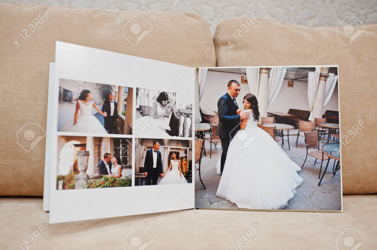 Pages Of Wedding Photobook Or Wedding Album On The Sofa With Stock Photo Picture And Royalty Free Image Image 82666678