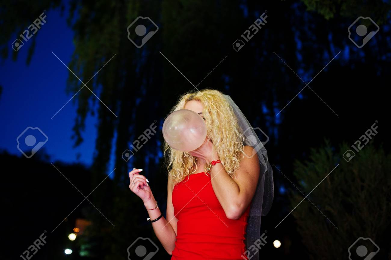 Crazy Bride In Red Dress And Veil Inflating Condom At Her ...
