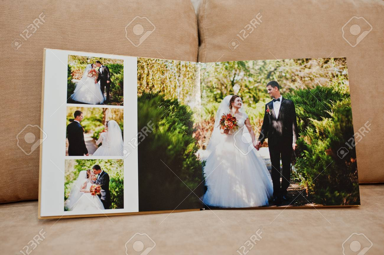 Wedding Photo Album.Pages Of Wedding Photobook Or Wedding Album On The Sofa With