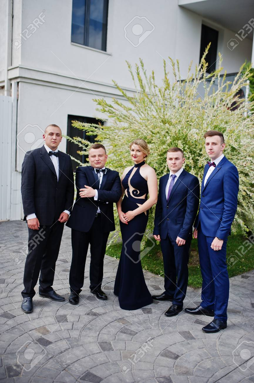Beautiful Girl In Evening Gown Standing Along With Men In Tuxedos ...