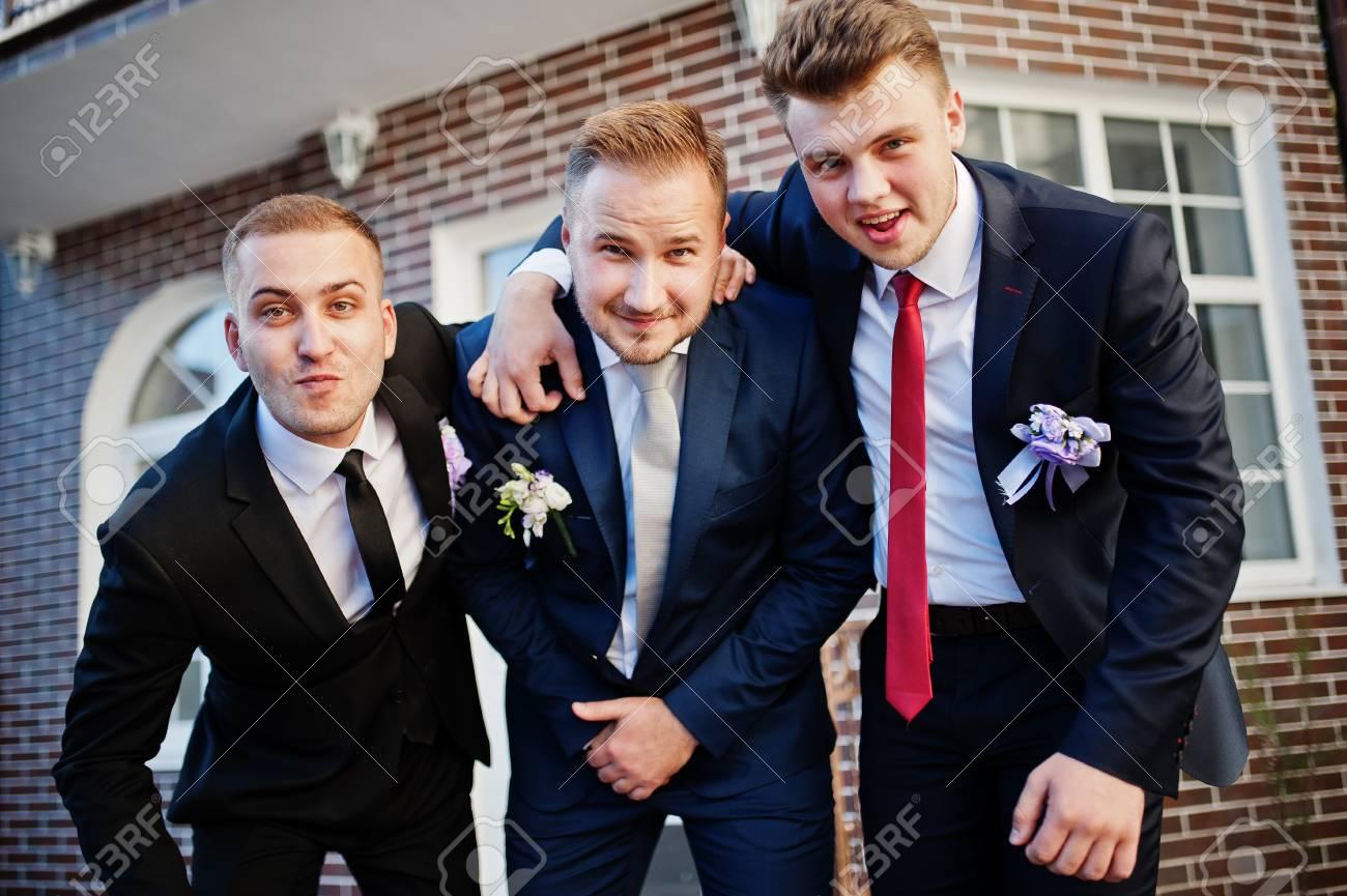 Handsome Groom In His Wedding Tuxedo Posing With Groomsmen Or