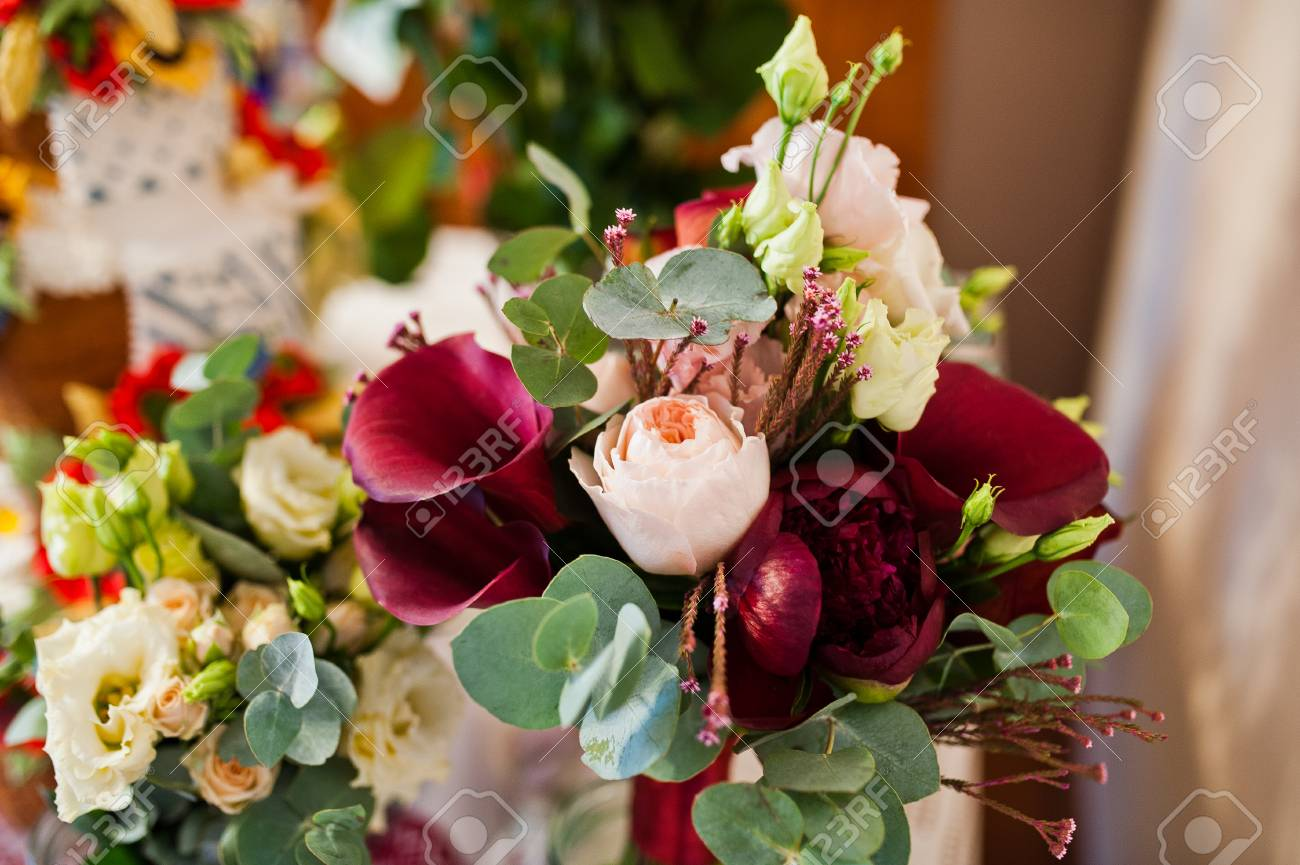 Close up photo of a wedding bouquet made from purple calla lilies close up photo of a wedding bouquet made from purple calla lilies and other flowers izmirmasajfo