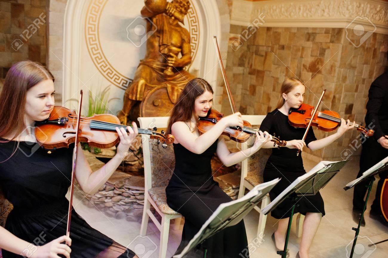 String Quartet Wedding.String Quartet Playing Instruments In The Restaurant On The Wedding