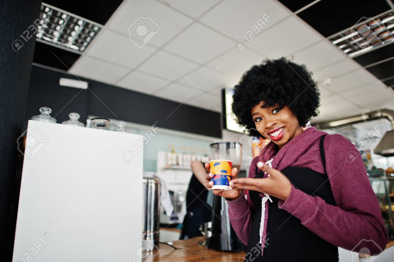 Curly Hair African American Woman Wear On Sweater Posed At Cafe