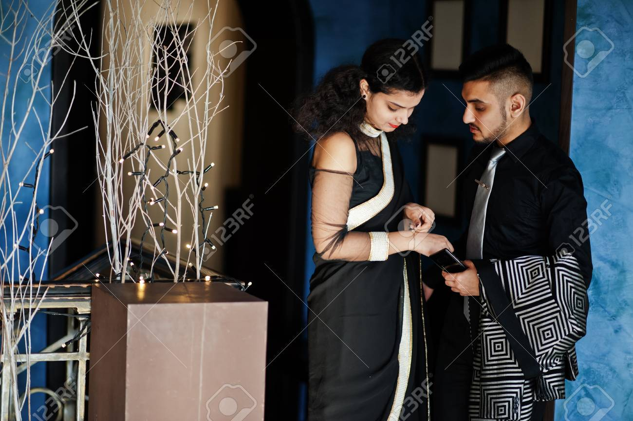 Lovely Indian Couple In Love Wear At Saree And Elegant Suit Stock Photo Picture And Royalty Free Image Image 119277090