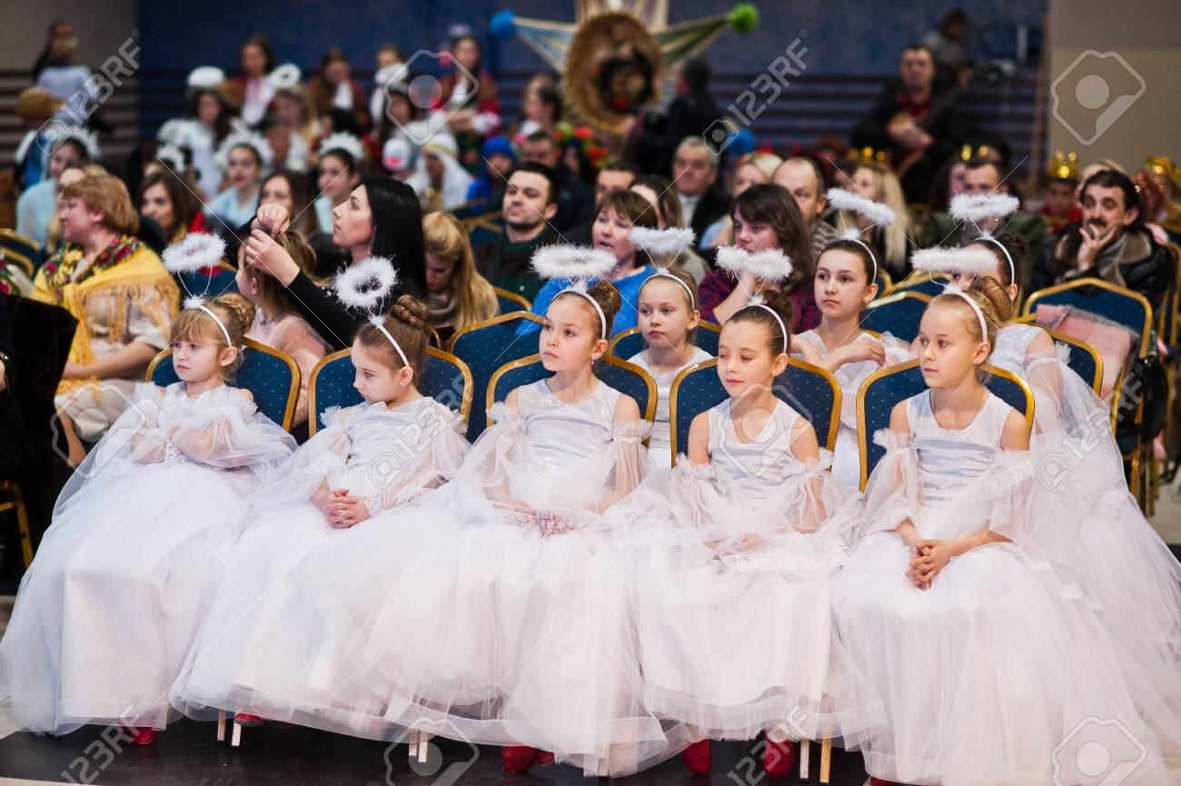 Kyiv, Ukraine - September 1, 2019: Childrens angels in white dresses at Christmas event. - 138123488