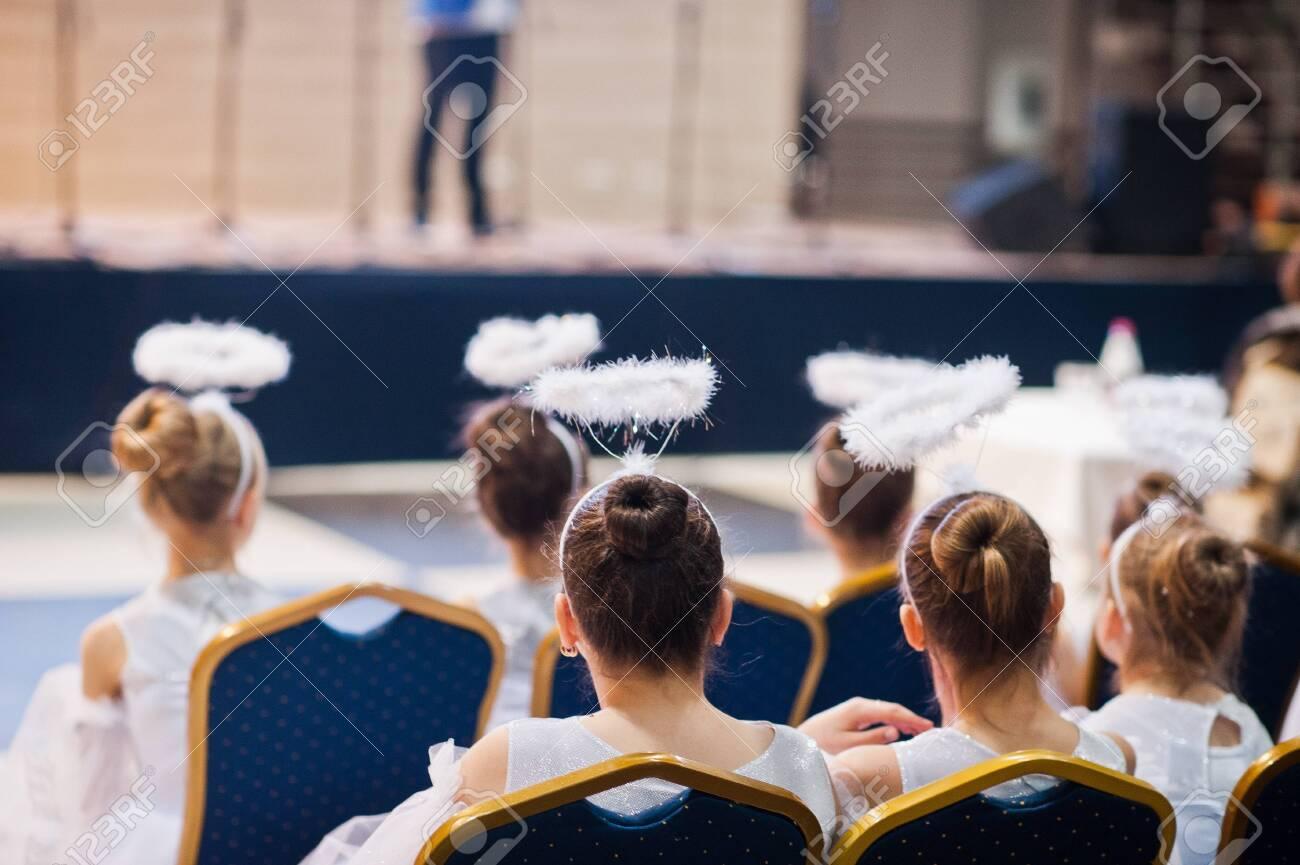 Kyiv, Ukraine - September 1, 2019: Childrens angels in white dresses at Christmas event. - 138123489