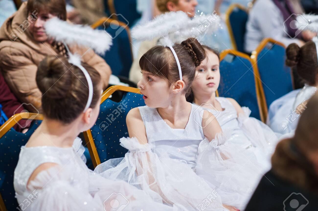 Kyiv, Ukraine - September 1, 2019: Childrens angels in white dresses at Christmas event. - 138123490