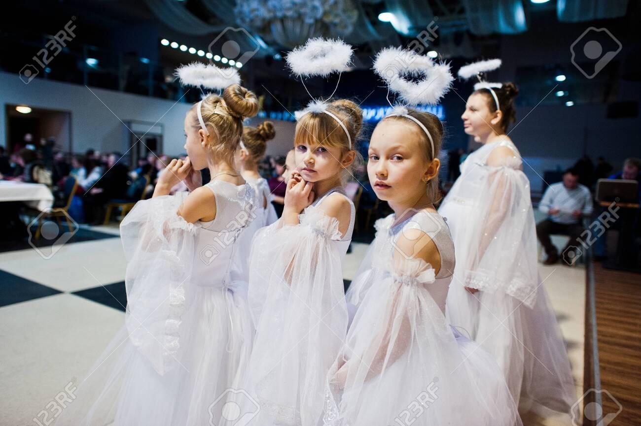 Kyiv, Ukraine - September 1, 2019: Childrens angels in white dresses at Christmas event. - 138123491