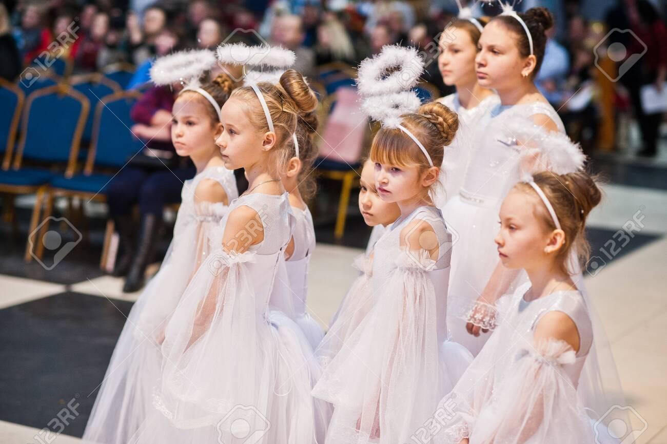 Kyiv, Ukraine - September 1, 2019: Childrens angels in white dresses at Christmas event. - 138123492