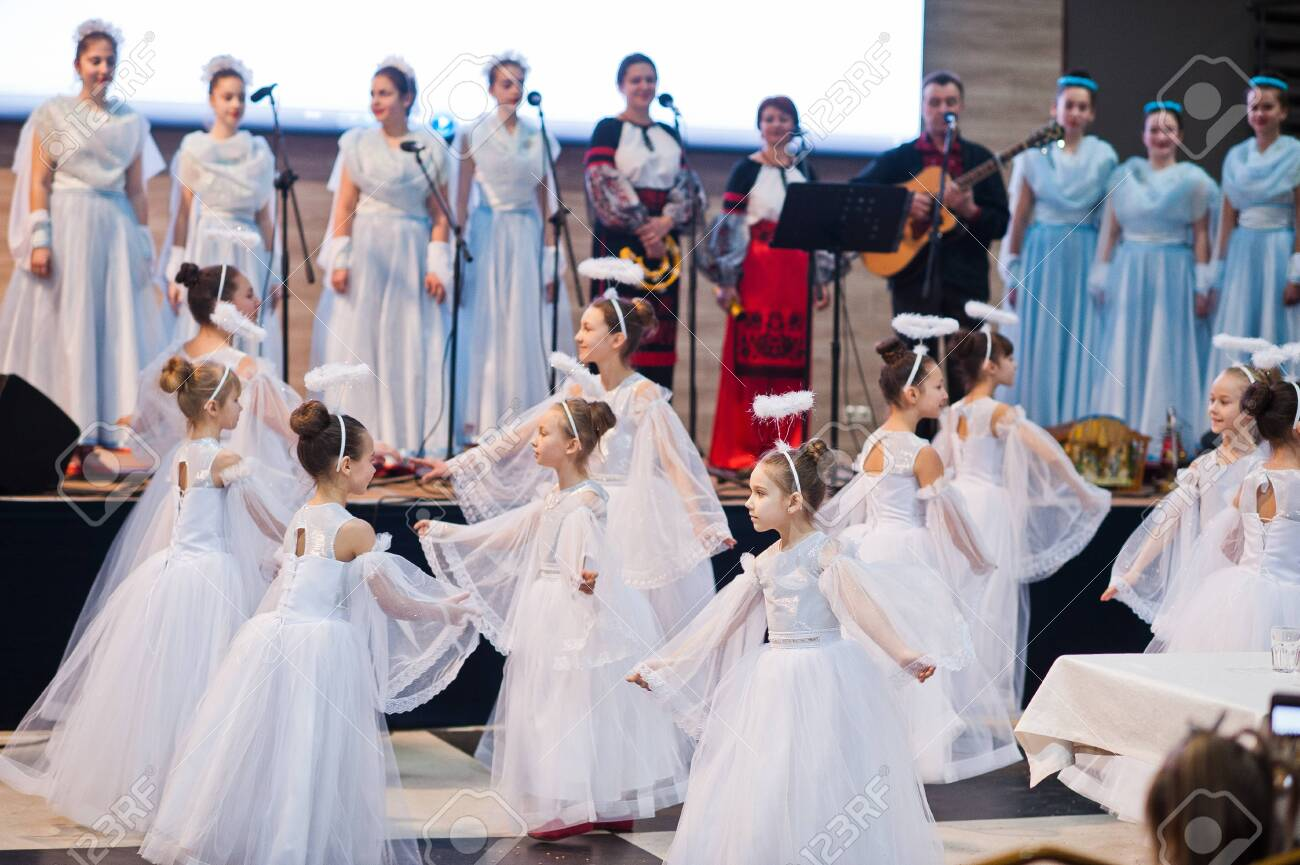 Kyiv, Ukraine - September 1, 2019: Childrens angels in white dresses at Christmas event. - 138123493