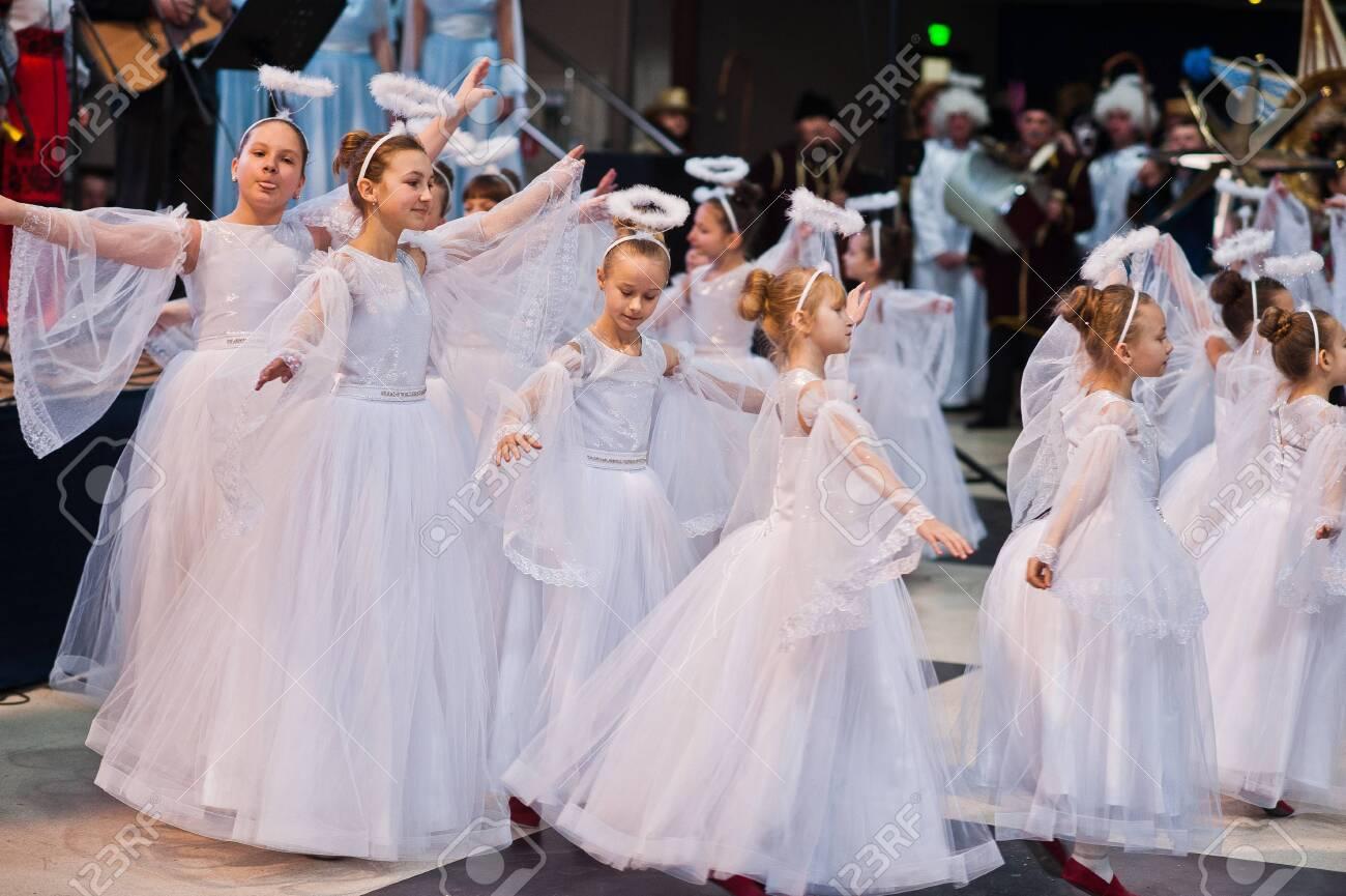 Kyiv, Ukraine - September 1, 2019: Childrens angels in white dresses at Christmas event. - 138123494