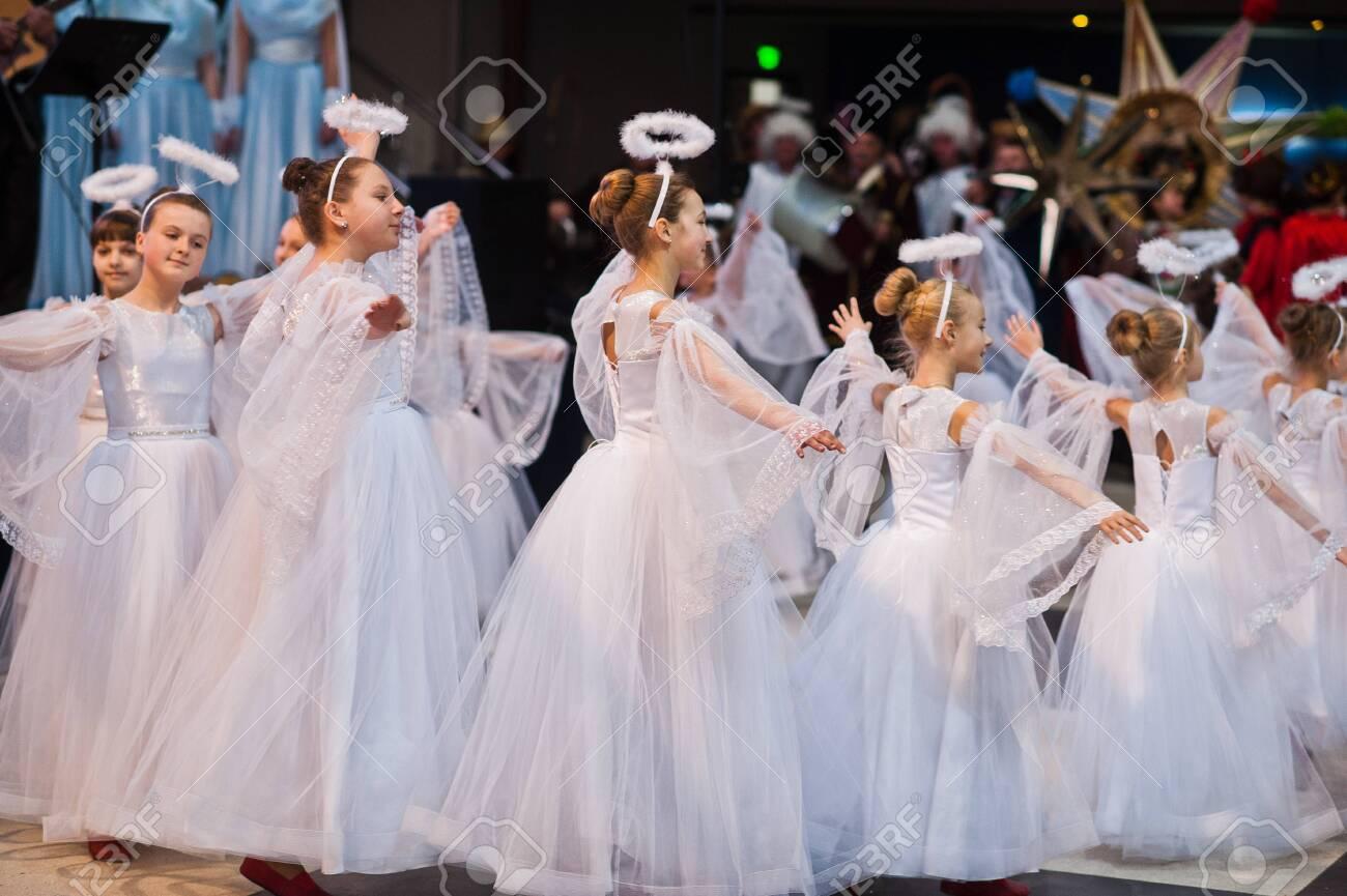 Kyiv, Ukraine - September 1, 2019: Childrens angels in white dresses at Christmas event. - 138123495