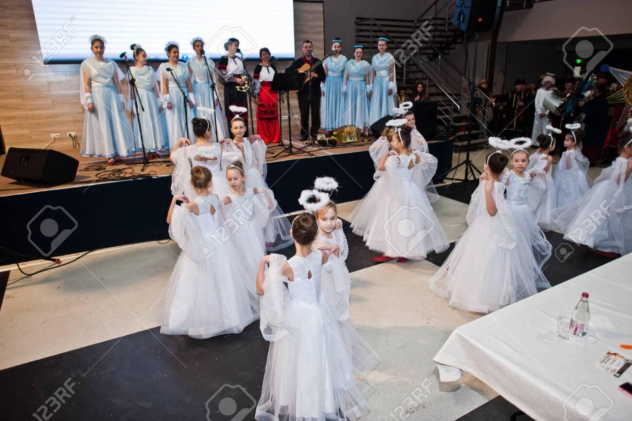 Kyiv, Ukraine - September 1, 2019: Childrens angels in white dresses at Christmas event. - 138123497