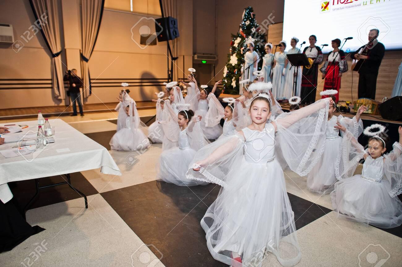 Kyiv, Ukraine - September 1, 2019: Childrens angels in white dresses at Christmas event. - 138123498