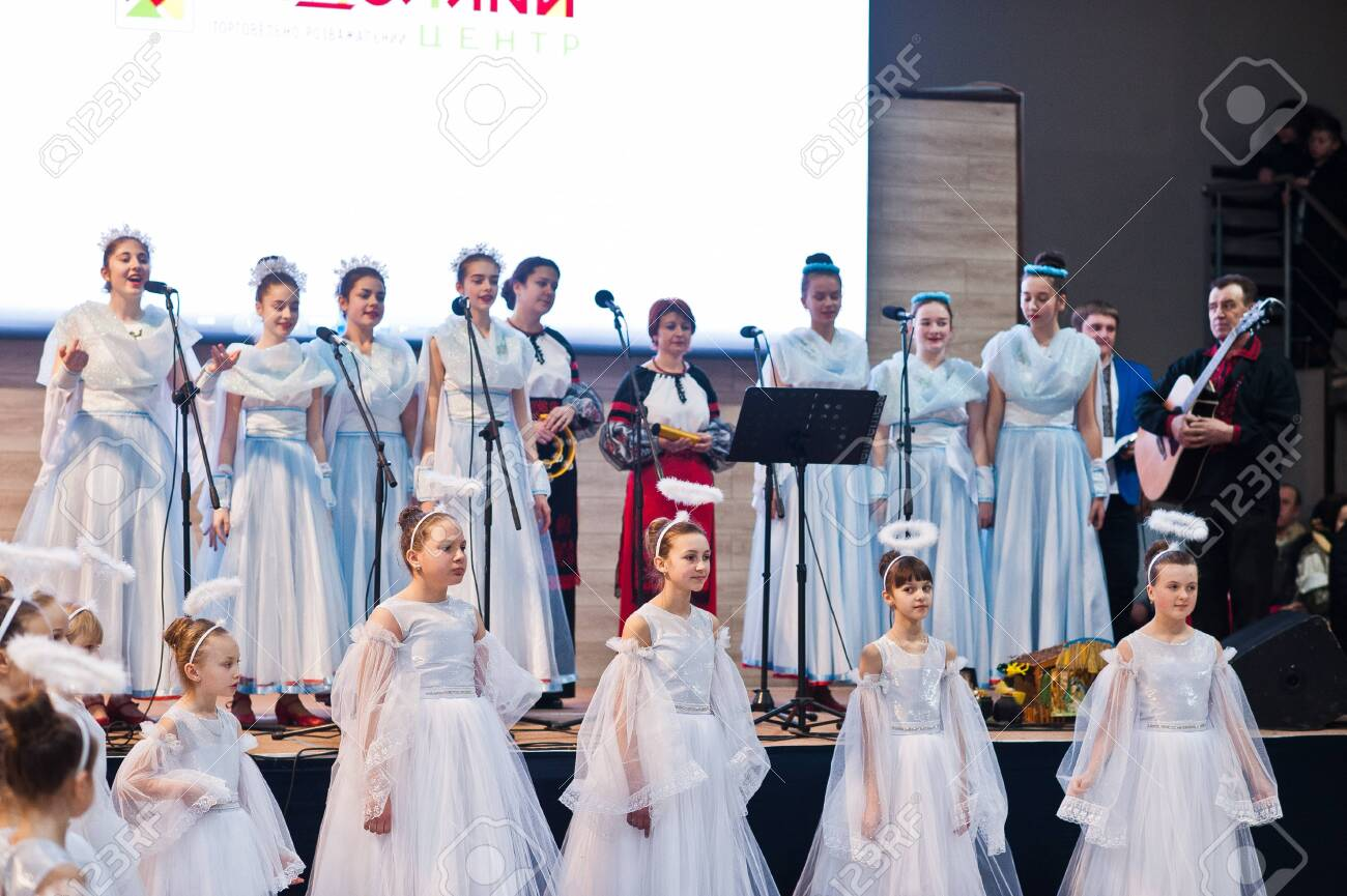 Kyiv, Ukraine - September 1, 2019: Childrens angels in white dresses at Christmas event. - 138123500