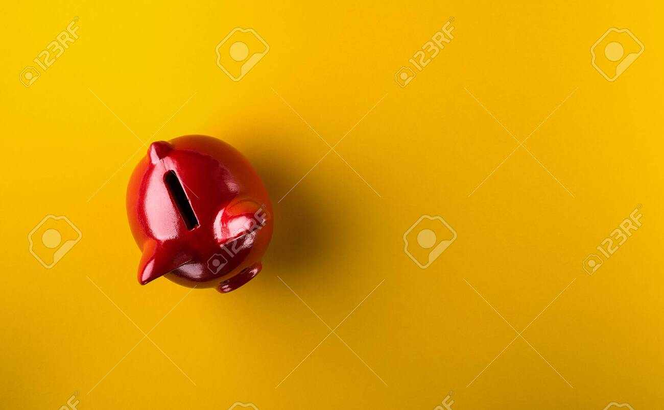 Red piggy bank on yellow background - 140728999
