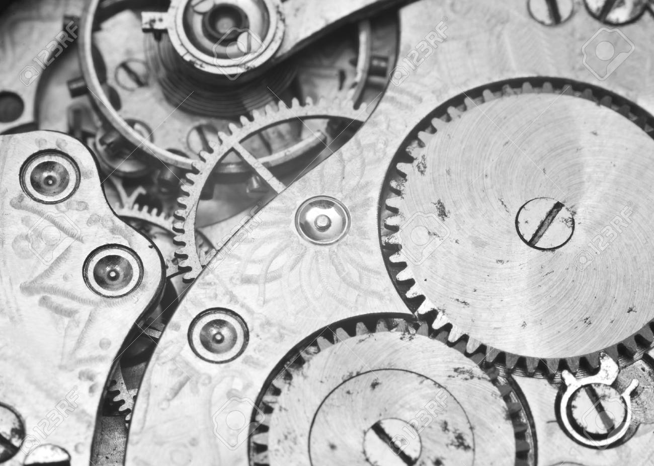 Black and white macro photo close up view of metal clockwork concept eternity
