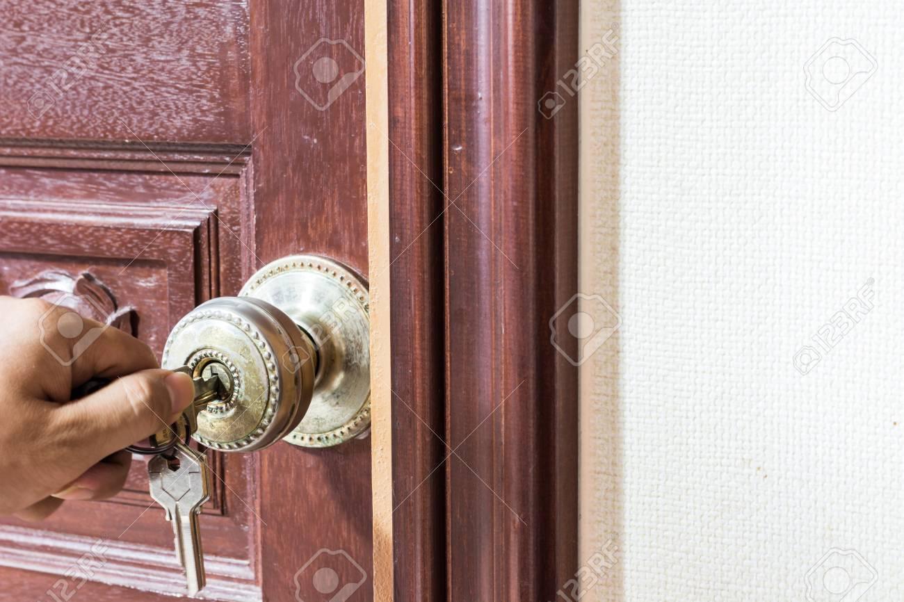 man hand Locking the Door - 38782940