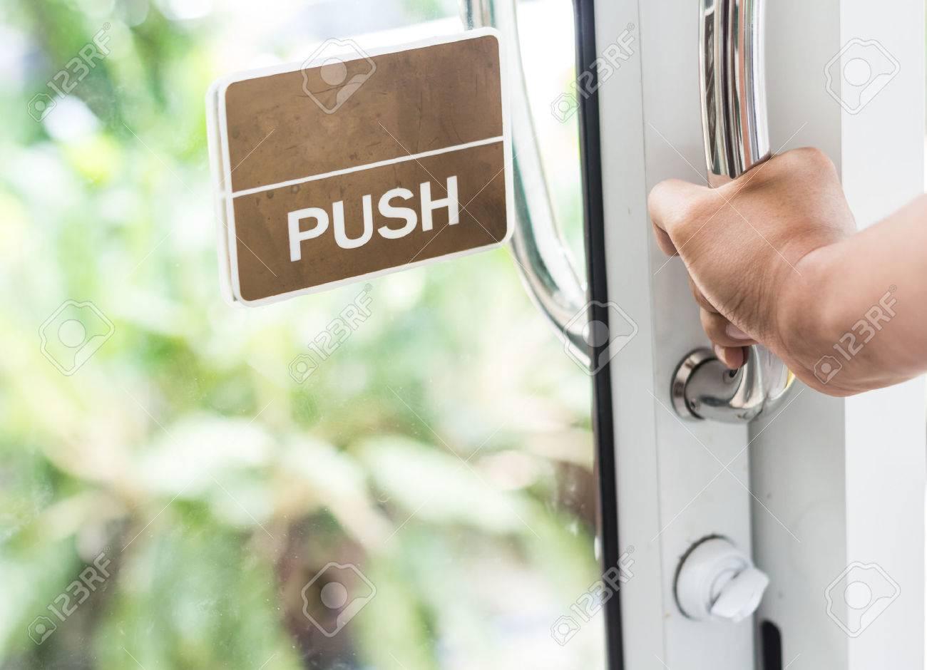hand push the door - hand focused - 42079029