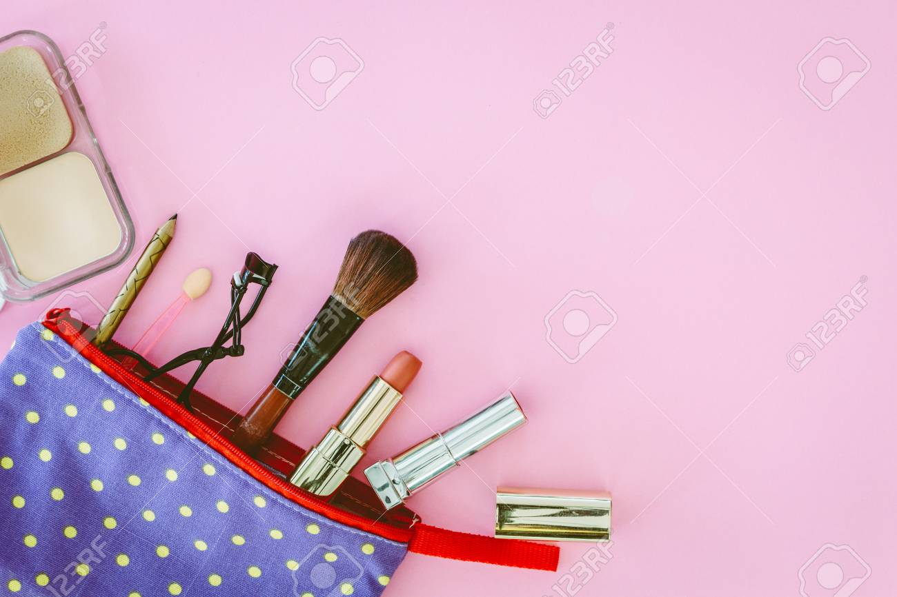 Make up bag with cosmetics on pink background - 88492521